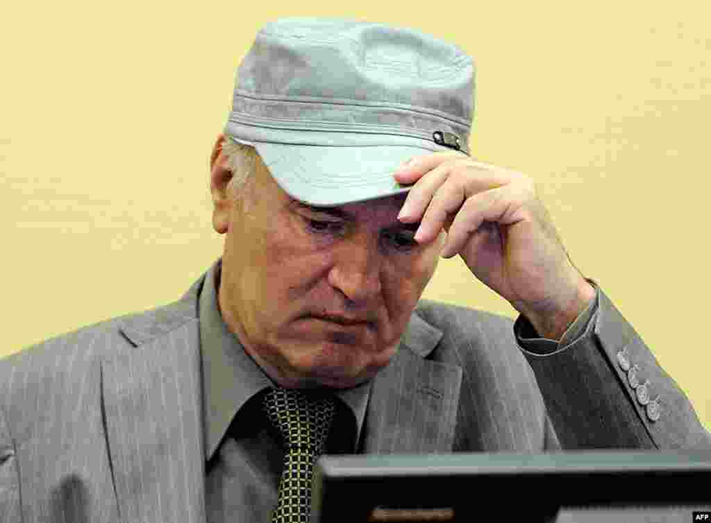 """June 3: Former Bosnian Serb Gen. Ratko Mladic removes his hat in the court room during his initial appearance at the U.N.'s Yugoslav war crimes tribunal in The Hague, Netherlands. Mladic told a United Nations war crimes court Friday he is """"a gravely ill m"""
