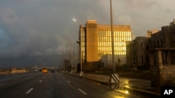 FILE - The setting sun shines on the facade of the United States Embassy, in Havana, Cuba, Oct. 14, 2017. Canada has no plans to remove its diplomats from Cuba, despite symptoms of potential illness among its diplomatic corps.
