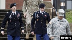 FILE - U.S. Army Sergeant Bowe Bergdahl, second from right, leaves the courthouse with his defense attorney, Lieutenant Colonel Franklin Rosenblatt, left, after an arraignment hearing for his court-martial in Fort Bragg, N.C., Dec. 22, 2015.