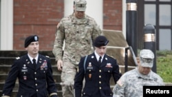 FILE - U.S. Army Sergeant Bowe Bergdahl, second from right, leaves the courthouse with his defense attorney, Lt. Col. Franklin Rosenblatt, left, after an arraignment hearing for his court-martial in Fort Bragg, North Carolina, Dec. 22, 2015.