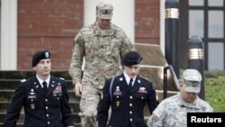FILE - U.S. Army Sergeant Bowe Bergdahl, second right, leaves the courthouse with his defense attorney, Lt. Col. Franklin Rosenblatt, left, after an arraignment hearing for his court-martial in Fort Bragg, North Carolina, Dec. 22, 2015.