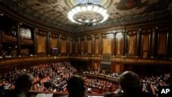 FILE - Italian Premier Giuseppe Conte addresses the Senate in Rome, July 24, 2019.