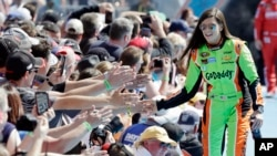 Driver Danica Patrick greets fans as she is introduced before the start of the Daytona 500 NASCAR Sprint Cup series auto race at Daytona International Speedway in Daytona Beach, Fla. Feb. 22, 2015