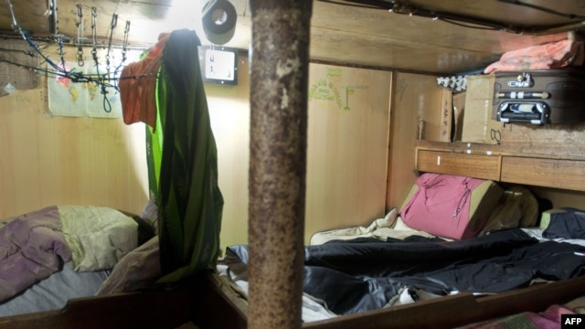 A shared bedroom in one of the seven rusted Taiwanese-registered fishing boats where 75 Indonesian fishermen have been living at Cape Town Harbor, Nov, 28, 2013.