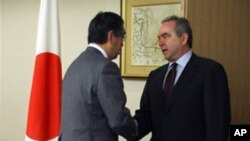 Kurt Campbell, U.S. assistant secretary of state for East Asia and Pacific affairs (R) meets newly appointed Japan's Foreign Minister Takeaki Matsumoto at the Foreign Ministry in Tokyo, March 10, 2011