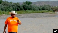 Navajo Nation Council Delegate Davis Filfred walks along the San Juan River, Aug. 11, 2015, in Montezuma Creek, Utah.