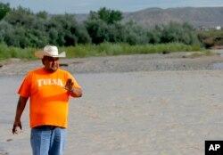 Navajo Nation Council Delegate Davis Filfred walks along the San Juan River, Aug. 11, 2015, in Montezuma Creek, Utah.