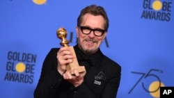 "Gary Oldman with the Golden Globe award for best performance by an actor in a motion picture - drama for ""Darkest Hour"" at the 75th annual Golden Globe Awards Sunday, Jan. 7, 2018, in Beverly Hills, Calif. (Photo by Jordan Strauss/Invision/AP)"