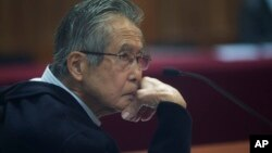 FILE - Peru's jailed, former President Alberto Fujimori, photographed through a glass window, attends his trial at a police base on the outskirts of Lima, Peru, June 28, 2016.