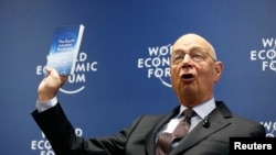 World Economic Forum (WEF) Executive Chairman and founder Klaus Schwab presents his book, 'The Fourth Industrial Revolution,' during a news conference in Cologny, near Geneva, Jan. 13, 2016.