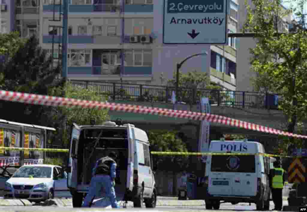 Forensic experts work at the scene after a bomb exploded at a bus stop during rush hour in Istanbul, Turkey, Thursday, May 26, 2011. A bomb placed on a bicycle near a bus stop exploded during morning rush hour in Istanbul on Thursday, injuring seven peopl