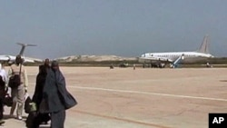 The presence of armed peacekeepers allows the few commercial planes that fly to Mogadishu to bring Somalis in and out of the capital and connect them to the rest of the world