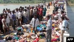 Sedikitnya 115 orang tewas dalam insiden saat festival keagamaan di distrik Datia, negara bagian Madhya Pradesh, India hari Minggu (13/10).