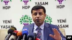 FILE - Pro-Kurdish Peoples' Democratic Party leader Selahattin Demirtas is seen speaking during a news conference in Ankara, Turkey, July 21, 2015.