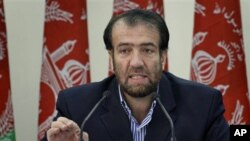 Election commission Chairman Fazel Ahmad Manawi speaks during the announcement of the final election results in Kabul, Afghanistan on Dec 1, 2010.