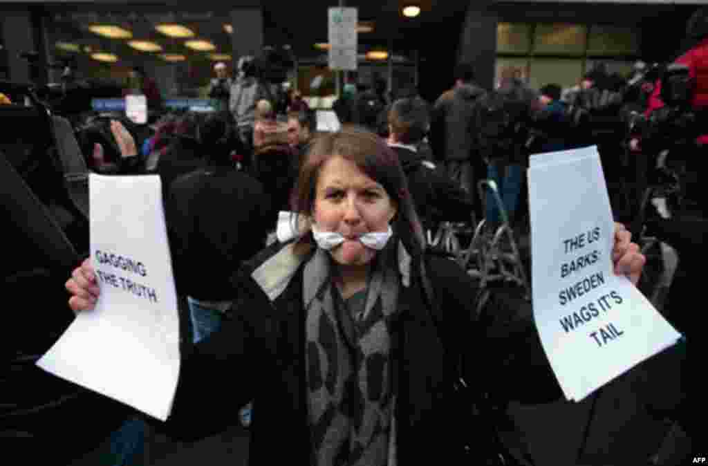 A supporter of Wikileaks founder Julian Assange outside the City of Westminster Magistrates Court in London where Julian Assange's case was heard, Tuesday, Dec. 7. (Lefteris Pitarakis/AP)