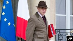 French Interior minister Bernard Cazeneuve leaves the weekly cabinet meeting at the Elysee Palace in Paris, Dec. 2, 2015.
