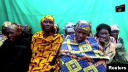 Remaining girls who were kidnapped from the northeast Nigerian town of Chibok are seen in an unknown location in Nigeria in this still image taken from an undated video obtained on Jan. 15, 2018.