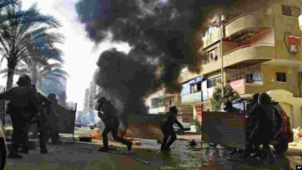Egyptian security forces clash with supporters of ousted President Mohamed Morsi in Cairo, Egypt, January 10, 2014.