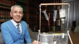 "Dr. Jack Kevorkian poses with his ""suicide machine"""