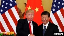 Predsjednici SAD i Kine, Donald Trump i Xi Jinping tokom susreta u Pekingu, 9. novembar 2017.
