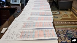A long row of voting tally sheets are lined up in the Senate Press Gallery during a marathon series of votes Dec. 3, 2015, on Capitol Hill in Washington.