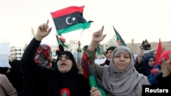 FILE - Demonstrators protest against what they say is French military intervention in Libya, at Martyrs Square in Tripoli, Libya, July 22, 2016.