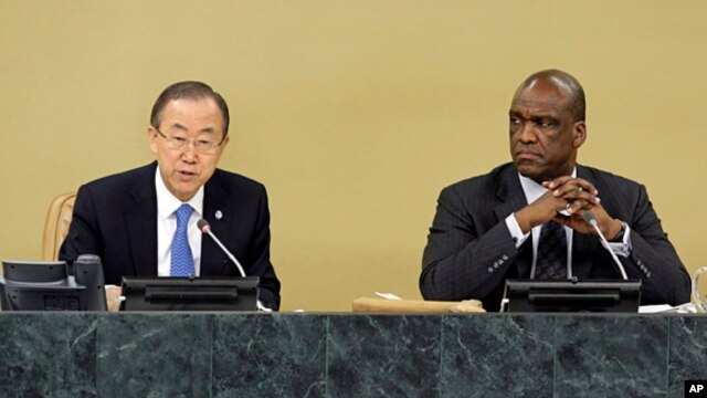UN Secretary General Ban Ki-moon (l) accompanied by General Assembly President John Ashe, addresses the High Level Meeting on Disability and Development during the 68th session of the United Nations General Assembly, Sept. 23, 2013