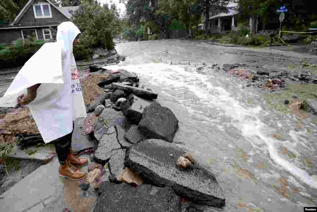 John Hoffenberg watches the flow of water increase in Boulder, Colorado, Sept. 15, 2013.