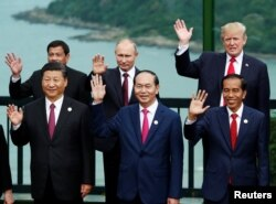 Leaders pose during the photo session at the APEC Summit in Danang, Vietnam, Nov. 11, 2017. Front, from left, China's President Xi Jinping, Vietnam's President Tran Dai Quang, Indonesia's President Joko Widodo; back, from left, Philippines' President Rodrigo Duterte, Russia's President Vladimir Putin and U.S. President Donald Trump.