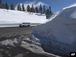 This photograph taken March 26, 2017, shows the record snow piled at the summit of the Mount Rose Highway (Nevada State Route 431) near the Mount Rose ski resort half way between Reno and Lake Tahoe. At an elevation of 8,911 feet, it is the highest highway pass open year-round in the Sierra Nevada.