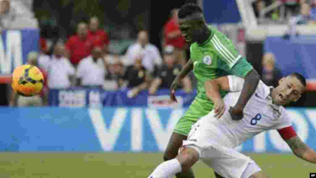 Nigeria's Reuben Gabriel and United States's Clint Dempsey.