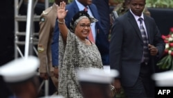 Kenya's first-lady, Margaret Kenyatta - wife of Kenya's President Uhuru Kenyatta - waves to supporters as she arrives in Nairobi on October 20, 2017, for commemorations of Mashujaa (Heroes) Day. (AFP PHOTO / TONY KARUMBA )