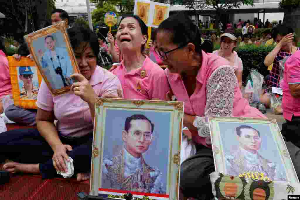 Well-wishers weep as they pray for Thailand's King Bhumibol Adulyadej at the Siriraj hospital where he was being attended to before his death, in Bangkok, Thailand. King Bhumibol Adulyadej has died after a long illness, the palace announced, ending a remarkable seven-decade reign and leaving a divided people bereft of a towering and rare figure of unity.