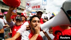 FILE - Backers of Venezuela's President Nicolas Maduro take part in a rally to support him in Caracas, Oct.18, 2014.