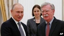 Russian President Vladimir Putin, left, and U.S. national security adviser John Bolton meet in the Kremlin in Moscow, Oct. 23, 2018.