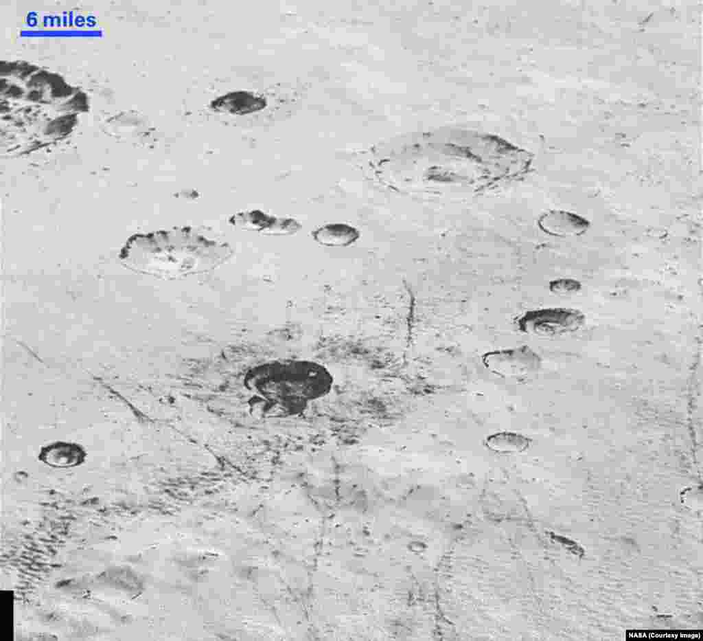 This highest-resolution image from NASA's New Horizons spacecraft reveals new details of Pluto's rugged, icy cratered plains, including layering in the interior walls of many craters, released Dec. 4, 2015.