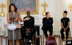 From left, first lady Michelle Obama introduces Grammy award-winning blues musician Keb' Mo', singer-songwriter Smokey Robinson and jazz musician Esperanza Spalding at the White House in Washington, Oct. 14, 2015.
