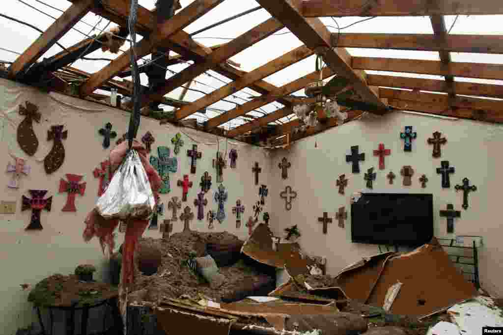 The living room of a home that had its roof blown off by a tornado, Cleburne, Texas May 16, 2013.