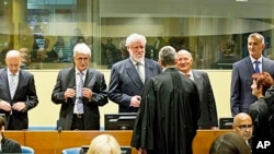 Back row from left: Bosnian Croats Jadranko Prlic, Bruno Stojic, Slobodan Praljak, Milivoj Petkovic and Valentin Coric prior to their judgment at the Yugoslav war crimes tribunal (ICTY) in The Hague, Netherlands, May 29, 2013.