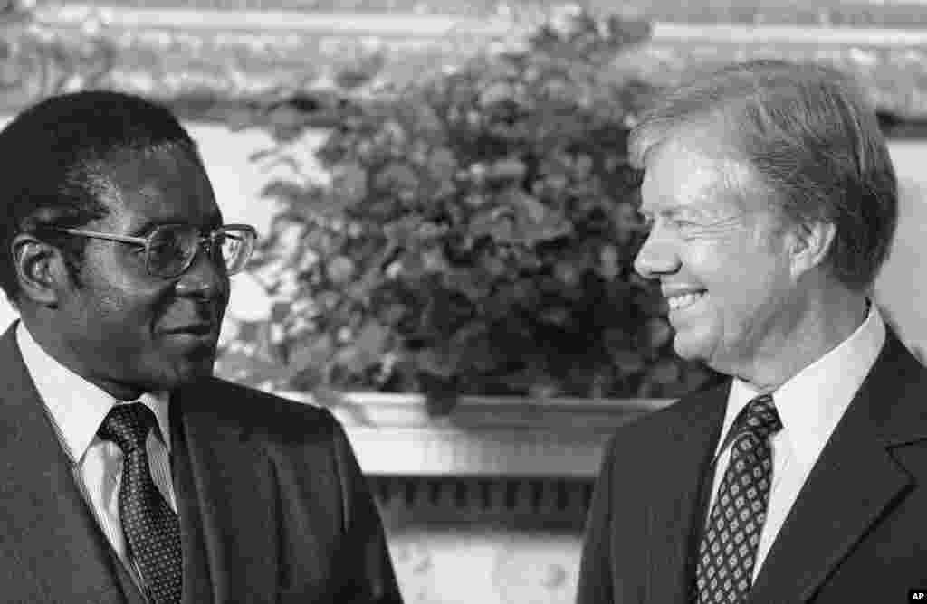 President Jimmy Carter meets Zimbabwe Prime Minister Robert Mugabe in the Oval Office in Washington on August 27, 1980. (AP Photo)