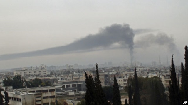 Smoke billows in Homs after the city is shelled by what activists say were Syrian troops, February 17, 2012.