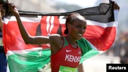 Jemima Sumgong (KEN) of Kenya celebrates after winning the Women's Marathon, Aug. 14, 2016.