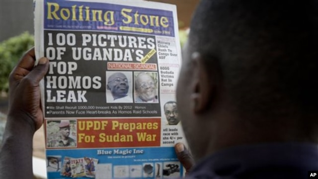 A Ugandan man reads the headline of the Ugandan newspaper 'Rolling Stone' in Kampala, Uganda, 19 Oct 2010