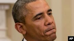 Presiden Barack Obama terdiam sejenak saat menjawab pertanyaan wartawan di Gedung Putih, Senin (3/3).