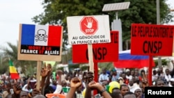 Opposition supporters attend a rally to celebrate the ousting of President Ibrahim Boubacar Keita, at the Independence Square in Bamako, Mali, Aug. 21, 2020.