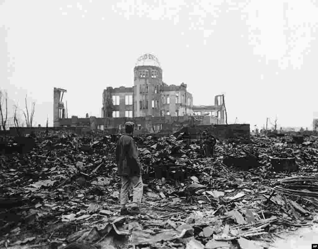 An Allied war correspondent stands amid the ruins of Hiroshima, Japan in 1945, just weeks after the city was leveled by an atomic bomb.