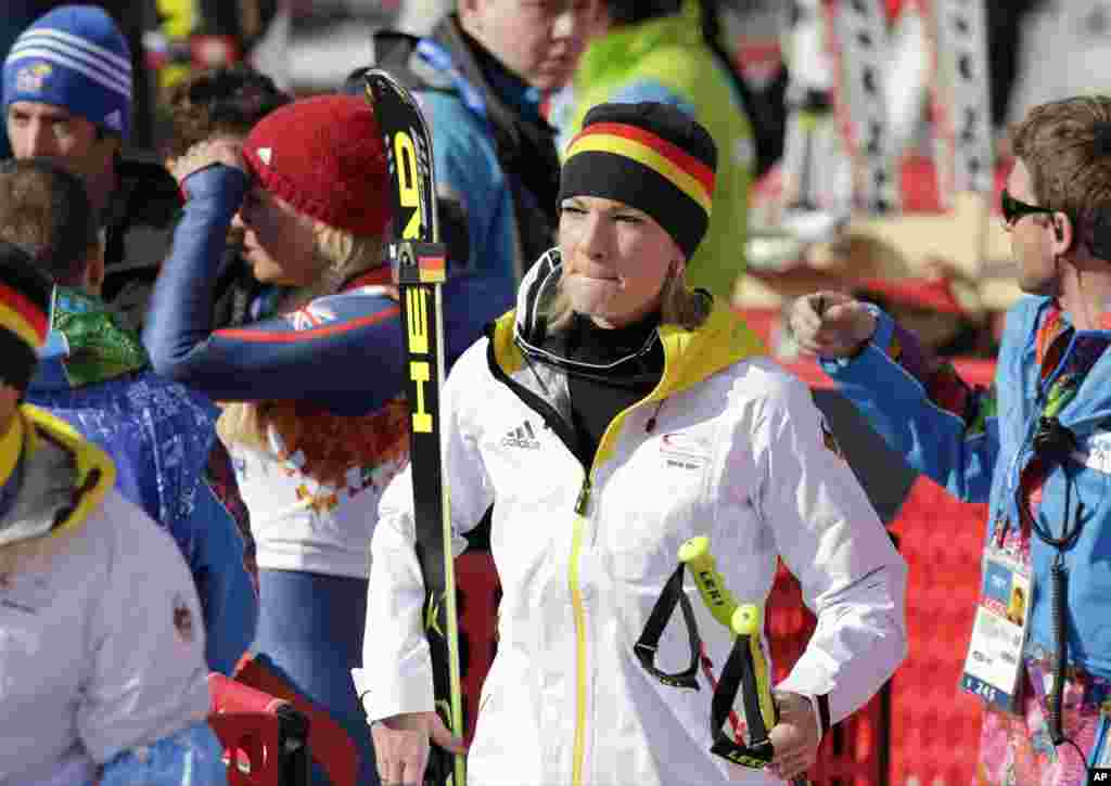 Germany's Maria Hoefl-Riesch leaves the finish area after competing in the downhill portion of the women's supercombined, Krasnaya Polyana, Russia, Feb. 10, 2014.