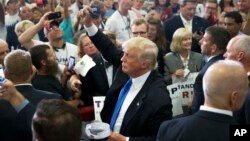Republican presidential candidate Donald Trump greets the crowd and signs autographs during a campaign rally at the Sharonville Convention Center, July 6, 2016, in Cincinnati, Ohio.