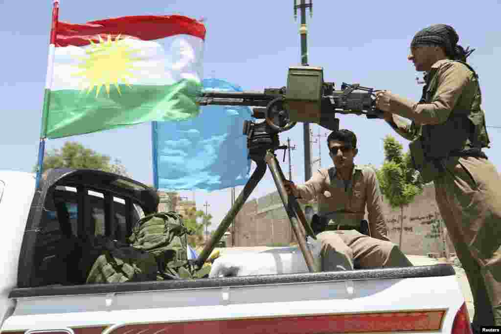 A military convoy drives towards Kirkuk, to reinforce Kurdish Peshmerga troops, Iraq, June 24, 2014.